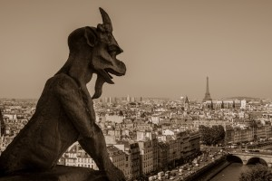 Gargoyle at the Notre Dame Cathedral overlooking the city of Paris, France
